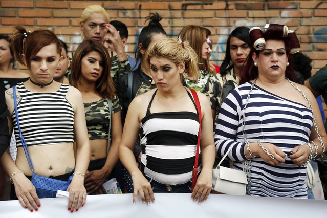 """In this September 30, 2017 photo, members of a gay organization """"Panambi"""", meaning butterfly in Guarani, protest the killing of transvestite prostitutes and demand equal rights for gays during the annual LGBQT parade in Asuncion, Paraguay. The ban on teaching sexual diversity in schools was implemented in October after the U.N. Children's Fund issued a guidebook for teachers on avoiding discrimination between girls and boys and achieving gender equality. (Photo by Jorge Saenz/AP Photo)"""