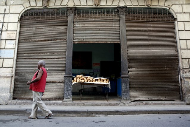 """A man walks past a subsidised state store, or """"bodega"""", where Cubans can buy basic products with a ration book they receive annually from the government in Havana September 18, 2015. (Photo by Carlos Garcia Rawlins/Reuters)"""