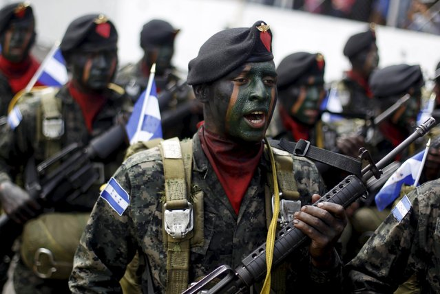 Soldiers walk in formation during an event to celebrate the Day of the Soldier at the Nacional Tibucio Carias Andino stadium in Tegucigalpa, Honduras, October 3, 2015. The Day of the Soldier is celebrated on October 3 in commemoration of late President Francisco Morazan. Morazan was thrice president of the Central American Federation, comprising Guatemala, Costa Rica, El Salvador, Honduras and Nicaragua after Central America split from Mexico in the 1820s. (Photo by Jorge Cabrera/Reuters)