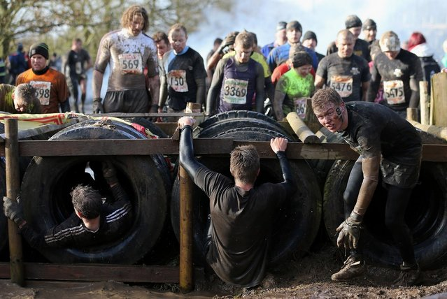 Competitors in action during the Tough Guy Challenge on January 27, 2013 in Telford, England.  (Photo by Ian Walton)