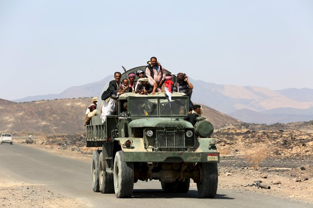 Tribal fighters loyal to Yemen's government ride a truck at the frontline of fighting against Houthi militants in the central province of Marib October 7, 2015. (Photo by Reuters/Stringer)