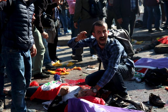 A man asks for help for an injured woman after an explosion during a peace march in Ankara, Turkey, October 10, 2015. (Photo by Tumay Berkin/Reuters)