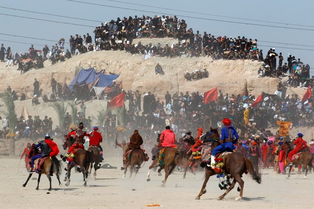 Iraqi Shi'ite Muslims ride horses as they re-enact a scene from the 7th century battle of Karbala to commemorate Ashura, the holiest day on the Shi'ite Muslim calendar, amid the spread of the coronavirus disease (COVID-19), in the holy city of Najaf, August 30, 2020. (Photo by Alaa Al-Marjani/Reuters)