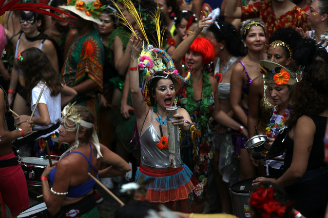 """Revellers take part in an annual block party known as """"Ceu na Terra"""" (Heaven on Earth), during carnival festivities in Rio de Janeiro, Brazil February 3, 2018. (Photo by Pilar Olivares/Reuters)"""