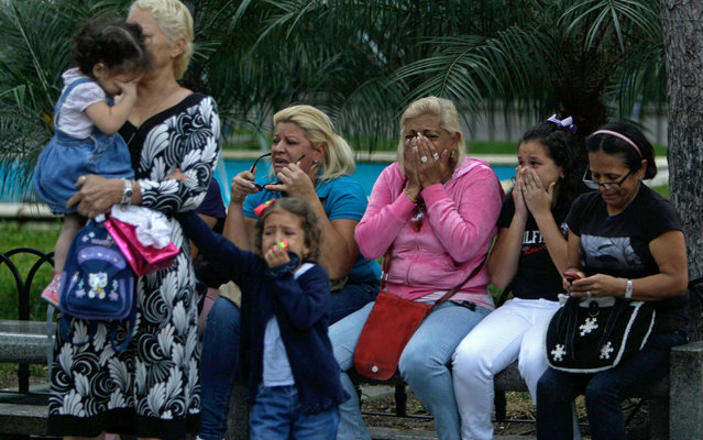 Women, including children, weep after the announcement of the death of Hugo Chávez, President of Venezuela. (Photo by Fernando Llano/AP Photo)