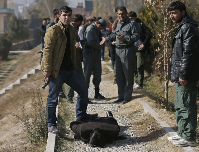 Security personnel arrest a suspect after a blast in Kabul, November 25, 2014. (Photo by Mohammad Ismail/Reuters)