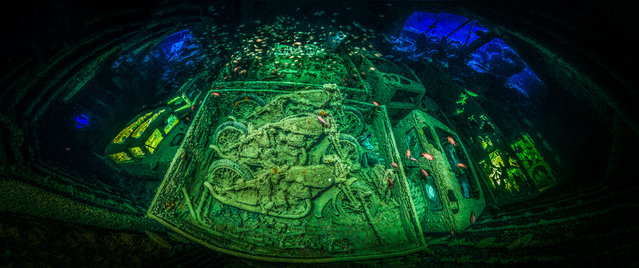 """Underwater photographer of the year – winner. """"Cycle War"""" by Tobias Friedrich (Germany). Location: SS Thistlegorm, Sharm el Sheikh, Egypt. """"Perfectly lit and composed, I predict that there will never be a better shot of this subject"""", one judge said. Friedrich had to create a panoramic image and use lights to give the image more depth, because of restricted space. (Photo by Tobias Friedrich/UPY 2018)"""
