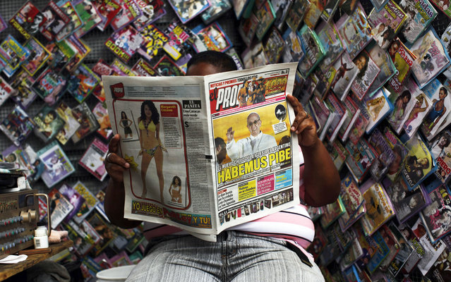 A man reads a newspaper featuring a photo of the newly elected Pope Francis, in downtown in Caracas,Venezuela, Thursday, March 14, 2013. Latin Americans reacted with joy on Wednesday at news that Argentina's former cardinal Jorge Mario Bergoglio, who chose the name Francis, had become the first pope ever from the Americas. (Photo by Rodrigo Abd/AP Photo)