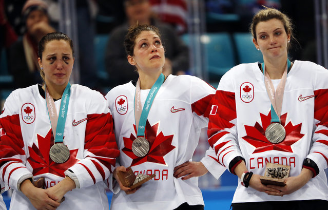 Canadian players win silver medals as they lose the women' s final ice hockey match against the United States as part of the 2018 Winter Olympic Games at the Gangneung Hockey Centre with a 2-3 score on February 22, 2018. (Photo by Grigory Dukor/Reuters)