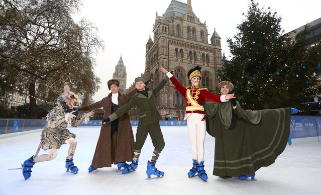 Members of the English National Ballets production of The Nutcracker (L-R) James Streeter, Josh McSherry-Gray, Grant Rae, Fernando Bufala and Yoko Callegari perform on ice at Natural History Museum on December 4, 2014 in London, England. Performances of The Nutcracker begin at The London Coliseum from December 11. (Photo by Tim P. Whitby/Getty Images)