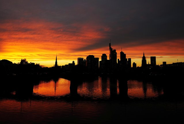 The skyline with its financial district is photographed during sunset as the spread of the coronavirus disease (COVID-19) continues in Frankfurt, Germany, October 26, 2020. (Photo by Kai Pfaffenbach/Reuters)