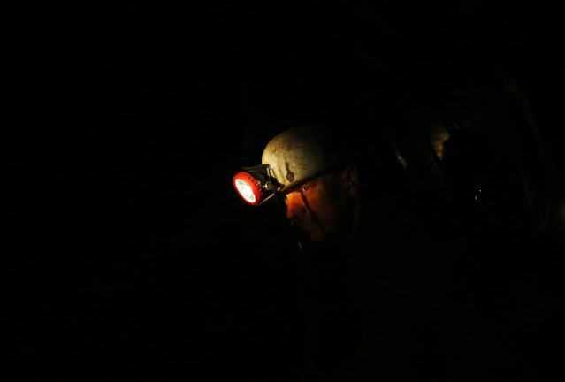 A miner prepares for his last working day at Hungary's last hard coal deep-cast mine at Markushegy December 23, 2014. (Photo by Laszlo Balogh/Reuters)