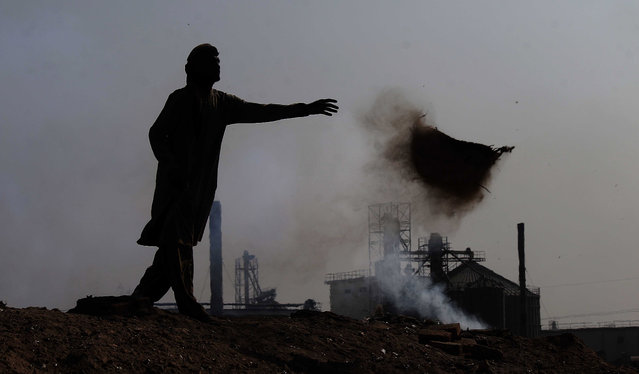 Smoke billows from factories on the outskirts of Karachi, Pakistan, 08 December 2020. According to reports, Pakistan's largest city and financial hub, Karachi's air quality reached dangerously unhealthy levels on 08 December and was recorded at 244 on the Air Quality Index (AQI). (Photo by Shahzaib Akber/EPA/EFE)