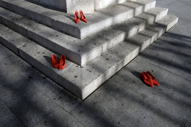 Red shoes are seen placed at Plaza Mayor, as part of an installation to protest against gender violence and femicide, in Valladolid, Spain November 25, 2015. (Photo by Juan Medina/Reuters)