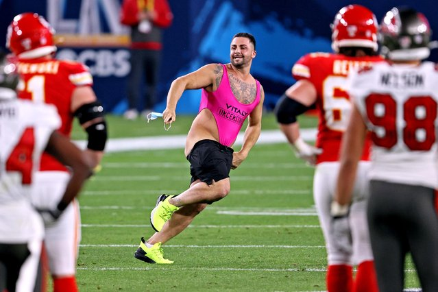 A pitch invader takes the field during the fourth quarter in Super Bowl LV between the Tampa Bay Buccaneers and the Kansas City Chiefs at Raymond James Stadium on February 07, 2021 in Tampa, Florida. (Photo by Matthew Emmons/USA TODAY Sports)