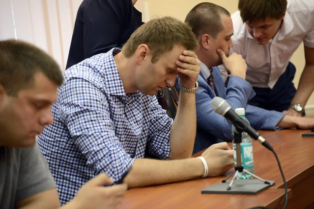 Russian opposition figure, Alexei Navalny (R), reacts as the court delivers the verdict in his trial, in the city of Kirov, Russia, 18 July 2013. (Photo by Valentina Svistunova/EPA)