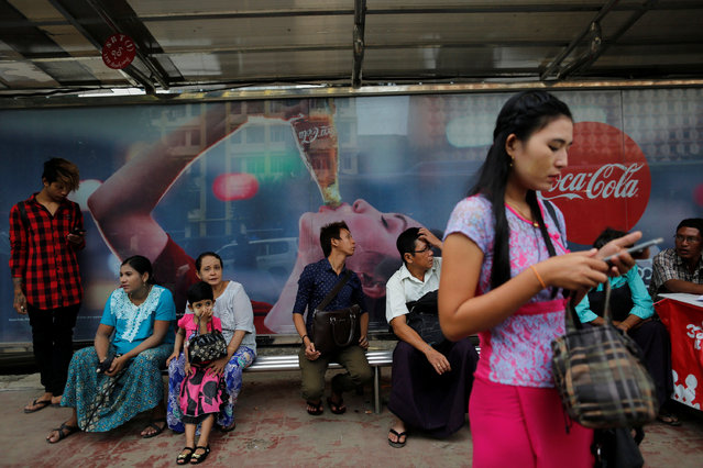 People wait at Sule bus stop in central Yangon, Myanmar, July 25, 2016. Picture taken July 25, 2016. (Photo by Soe Zeya Tun/Reuters)