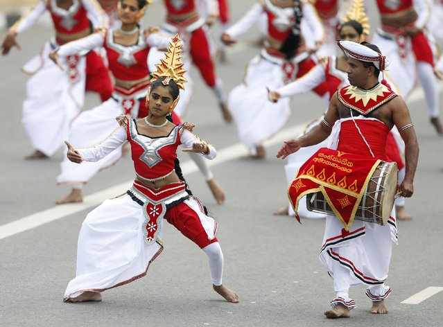 Traditional dancers perform during Sri Lanka's 67th Independence day celebrations in Colombo February 4, 2015. (Photo by Dinuka Liyanawatte/Reuters)