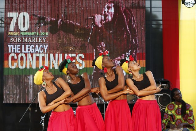 Members of the Quilt Performing Arts Company perform during a concert in celebration of the 70th anniversary of the birth of late reggae legend Bob Marley in Kingston February 6, 2015. Jamaicans celebrate Marley's 70th birthday on Friday with a jamming session at his former home and a free concert as the Caribbean island continues to wrestle over his place in its pantheon of heroes. (Photo by Gilbert Bellamy/Reuters)