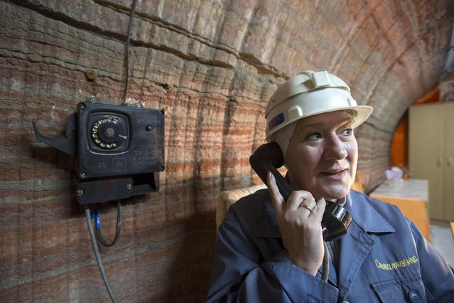 A nurse of Belarus' Republican Clinic of Speleotherapy speaks on the phone in a salt mine near the town of Soligorsk, south of Minsk, February 19, 2015. (Photo by Vasily Fedosenko/Reuters)