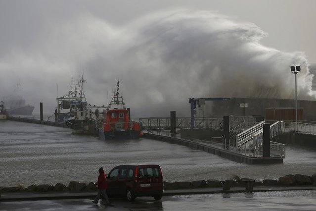 A crashes on the protecting wall at the fishing harbour in Pornic, France as stormy weather with high winds hits the French Atlanitic coast January 11, 2016. (Photo by Stephane Mahe/Reuters)