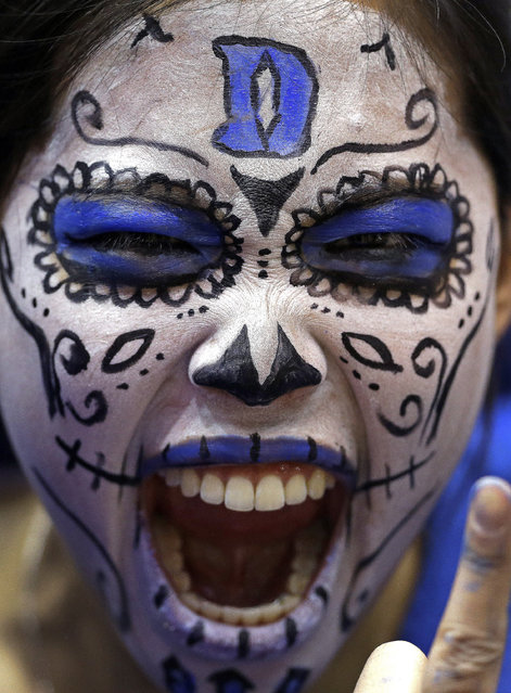 A Duke fan yells prior to Duke's NCAA college basketball game against North Carolina in Durham, N.C., Wednesday, February 18, 2015. (Photo by Gerry Broome/AP Photo)
