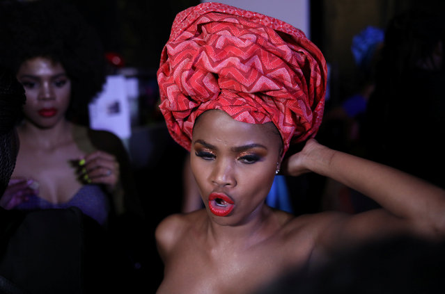 A model waits backstage before participating in AFI Joburg Fashion Week show with the theme #AfroAsia, in Johannesburg, South Africa October 4, 2018. Picture taken October 4, 2018. (Photo by Siphiwe Sibeko/Reuters)