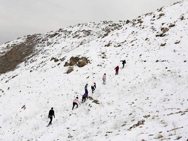 Members of Afghanistan's Women's National Cycling Team exercise on a snowy mountain in Qargha outskirts of Kabul March 9, 2015. (Photo by Mohammad Ismail/Reuters)