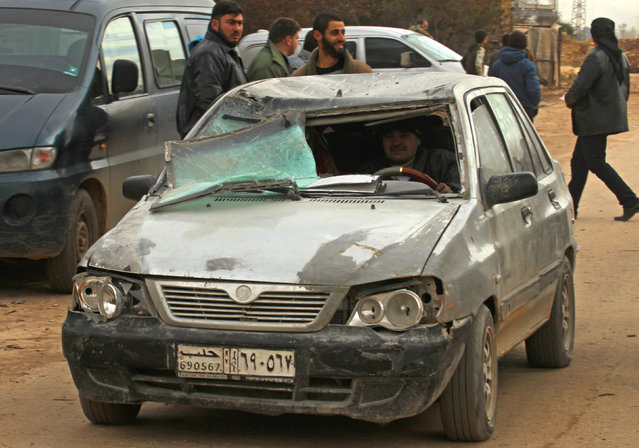 Evacuees from rebel-held eastern Aleppo, arrive in a car with a shattered windscreen to an area on the western edge of Aleppo city which is held by insurgents, in Syria December 16, 2016. (Photo by Ammar Abdullah/Reuters)