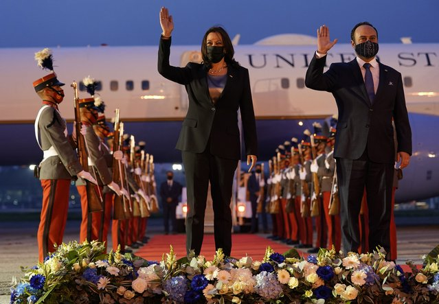 Vice President Kamala Harris and Guatemala's Minister of Foreign Affairs Pedro Brolo wave at her arrival ceremony in Guatemala City, Sunday, June 6, 2021, at Guatemalan Air Force Central Command. (Photo by Jacquelyn Martin/AP Photo)