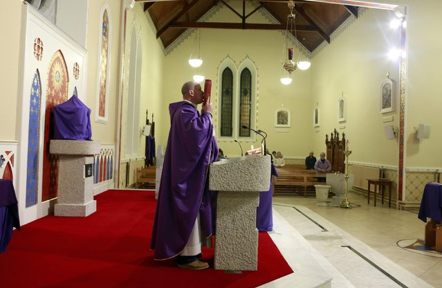 Fr Pierre Pepper delivers mass at St Rynagh's Roman Catholic Church in the village of Banagher County Offaly March 2, 2015. (Photo by Cathal McNaughton/Reuters)