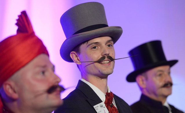 "Juhana Helmenkalastaja competes in the ""Moustache English"" category of the World Beard Championships on November 2, 2013 in Leinfelden-Echterdingen, southern Germany. More than 200 competitors from over 20 countries take part in the event. (Photo by Franziska Kraufmann/AFP Photo/DPA)"