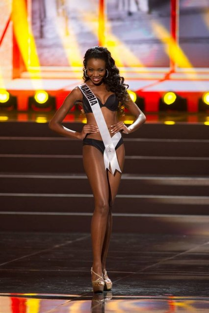 This photo provided by the Miss Universe Organization shows Paulina Malulu, Miss Namibia 2013, competes in the swimsuit competition during the Preliminary Competition at Crocus City Hall, Moscow, on November 5, 2013. (Photo by Darren Decker/AFP Photo)