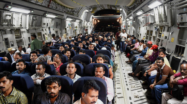 Indians evacuated from Yemen sit inside the Indian Air Force C17 Globemaster aircraft upon their arrival at Chhatrapati Shivaji International Airport in Mumbai, India, Thursday, April 2, 2015. India is evacuating its citizens from Yemen amid the growing violence in the Middle Eastern country. (Photo by Mitesh Bhuvad/AP Photo/Press Trust of India)