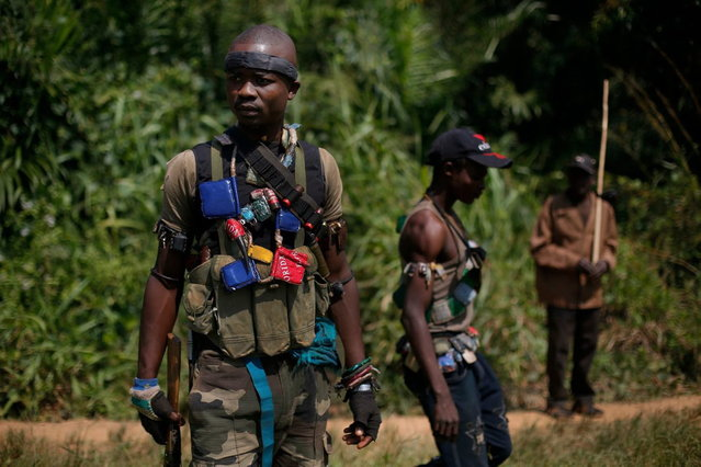 Anti-Balaka Christian militiamen walk through a forest clearing outside Central African Republic's capital Bangui Sunday December 15, 2013. (Photo by Jerome Delay/AP Photo)