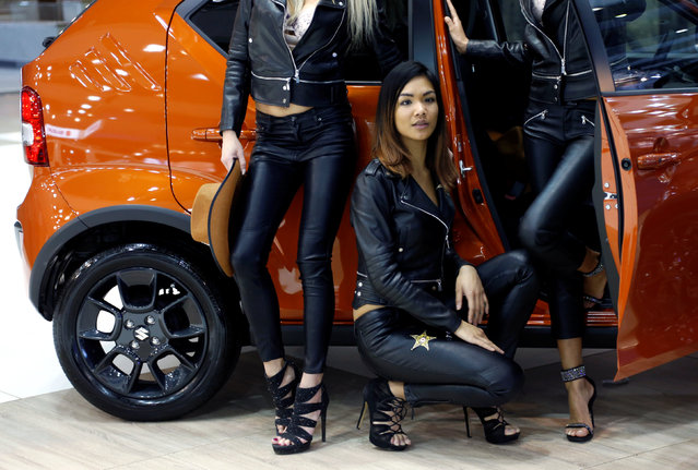 Hostesses pose in front of a Suzuki Ignis car at the European Motor Show in Brussels, Belgium, January 13, 2017. (Photo by Francois Lenoir/Reuters)