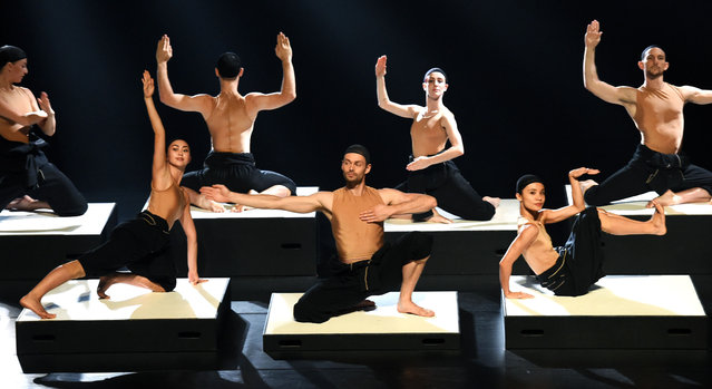 """Dancers perform during a media call for the Sydney Dance Company's """"CounterMove"""", comprising works by acclaimed Swedish choreographer Alexander Ekman and Sydney Dance Company Artistic Director Rafael Bonachela, in Sydney on February 29, 2016. The performance also marks the Company's first European co-production in partnership with the internationally acclaimed Dresden-Frankfurt Dance Company. (Photo by William West/AFP Photo)"""