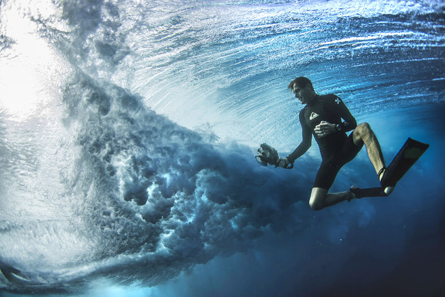 A daredevil photographer surfer Ben Thouard. (Photo by Ben Thouard/Caters News)