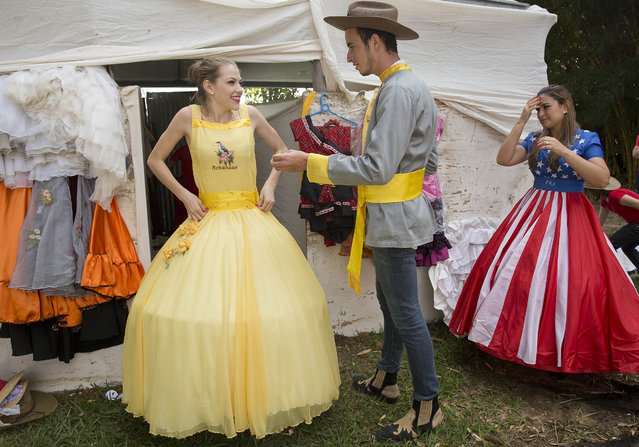 Descendants of American Southerners Wearing Confederate-era dresses and uniform prepare to attend a party to celebrate the 150th anniversary of the end of the American Civil War in Santa Barbara d'Oeste, Brazil, Sunday, April 26, 2015. The party maks the end of the American Civil War and it took place not in the deep south but rather some 5,000 miles (8,000 kilometers) south of there – in a town in rural Brazil colonized by families fleeing Reconstruction. (Photo by Andre Penner/AP Photo)