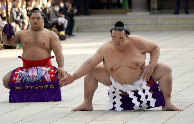 In this January 9, 2018, file photo, sumo grand champion Kisenosato, right, of Japan performs his ring entry form with sward-holder Shohozan at the Meiji Shrine in Tokyo. Grand champion Kisenosato, the only Japanese wrestler at sumo's highest rank, has decided to retire after three straight losses at the New Year Grand Sumo Tournament. Kisenosato needed a strong start to the New Year tourney to salvage his career but wasn't able to win in the first three days and decided to retire, his stablemaster said on Wednesday, Jan. 16, 2019. (Photo by Shizuo Kambayashi/AP Photo)