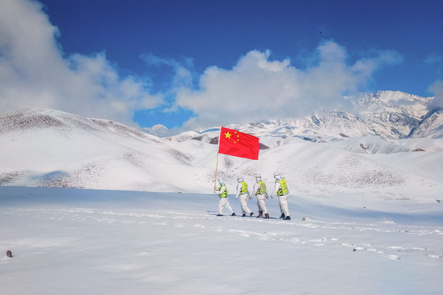 This photo taken on October 7, 2021 shows police officers patrolling along the border in Yili in China's western Xinjiang region. (Photo by AFP Photo/China Stringer Network)