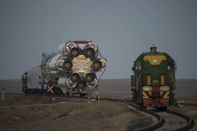 The Proton rocket, that will launch the ExoMars 2016 spacecraft to Mars, is transfered to the launchpad at the Baikonur cosmodrome, Kazakhstan, in this handout photo released by European Space Agency (ESA) on March 11, 2016. (Photo by Stephane Corvaja/Reuters/ESA)