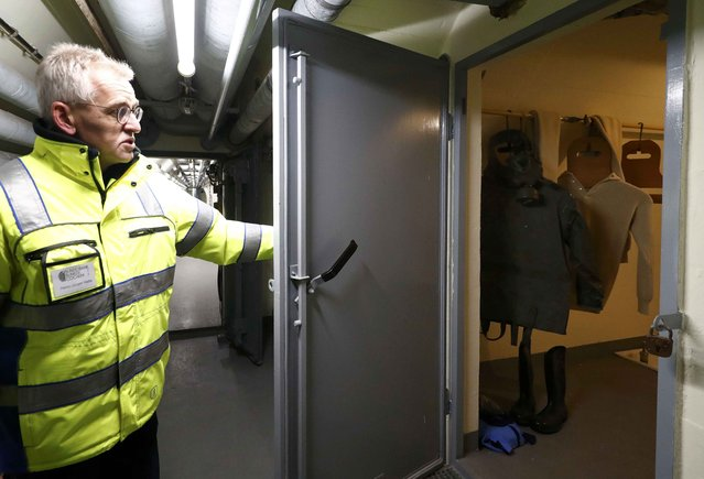 Tour guide Hans-Juergen Haite opens a decontamination chamber inside a Federal Reserve bank (Bundesbank) bunker, prior to the bunker's official opening to the public in Cochem, Germany, March 18, 2016. (Photo by Kai Pfaffenbach/Reuters)