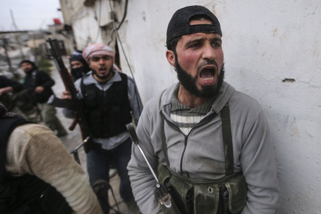 "A Syrian rebel shouts the Islamic phrase, Allahu Akbar or ""God is Great"", before the group attacks a government controlled army checkpoint in the Ain Tarma neighborhood of Damascus January 30, 2013. (Photo by Goran Tomasevic/World Press Photo)"