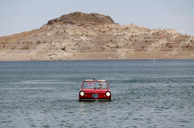 James Spears takes his 1964 German built Amphicar for a drive on Lake Mead in Nevada May 6, 2015. A prolonged drought in the Western United States has drastically affected the level of the lakes water. (Photo by Mike Blake/Reuters)
