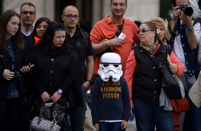 "A young ""Star Wars"" fan wearing a stormtrooper helmet attends an event marking Star Wars Day in Milan on May 3, 2015. (Photo by Filippo Monteforte/AFP Photo)"