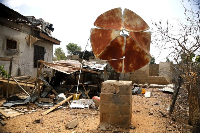 A broken satellite dish is seen at a destroyed residence in the town of Mararaba after the Nigerian military recaptured it from Boko Haram, in Adamawa state May 10, 2015. (Photo by Akintunde Akinleye/Reuters)