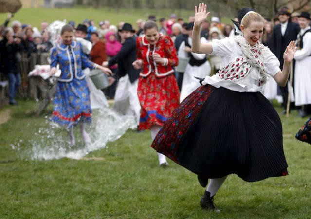 Girls run as boys throw water at them as part of traditional Easter celebrations in Szenna, Hungary, March 28,2016. (Photo by Laszlo Balogh/Reuters)