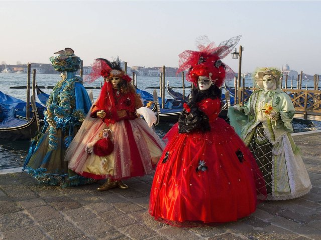During the Carnival Venice, the most magical of cities fills with a mass of masked participants posing and preening, dancing and philandering, in a slightly surreal re-invention of a great tradition of the city. (Photo by Marco Secchi/Getty Images)
