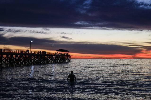 Sunset over Grange beach in Adelaide, Australia on March 28, 2019. (Photo by Amer Ghazzal/Barcroft Media)